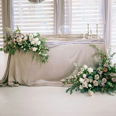 This is what I would like my head table piece to look like. Split up into two pieces and having like a lush climbing effect. Obviously just in my flowers/colors.