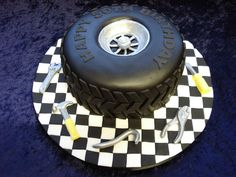 A cake for a car mechanic. Really enjoyed making this cake, even sticking all the individual black & white squares on the board and the tyre treads. Cake is an vanilla filled with jam and vanilla buttercream. Everything completely edible. Mechanic Cake, Auto Mechanic, Fun Cupcakes, Cupcake Cakes, Motor Cake, Tire Cake, Truck Cakes, Candy Cakes, Cakes For Men