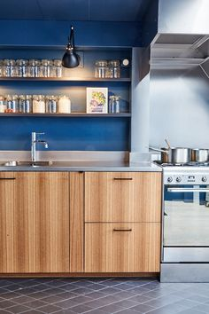 This inky blue kitchen decor features Farrow & Ball Stiffkey Blue.  Interior Architects : Les Filles d'Intérieur  Photographer : David Japy