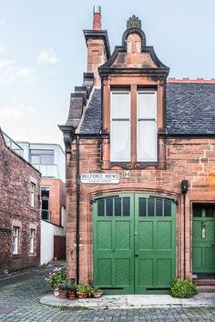 Mews with green doors in Edinburgh above the beautiful Dean Village area. #mews #edinburgh #scotland #doors