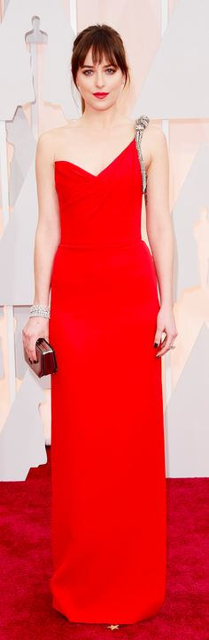 Dakota Johnson in a red one-shouldered Saint Laurent dress at the Oscars