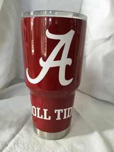Custom powder coated Yeti Rambler with Alabama Crimson Tide powder coated logos. No decal. All cups come with stainless bottom unless requested.