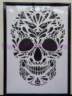 Sugar Skull Paper Cut Framed. Sugar Skull Papercut hand crafted by myself using Wildchild Designs stunning template. A4 hand cut on white cardstock. Mounted onto a colour of your choice and framed in black or silver as requested. The papercut can be cut on any colour and backed onto a colour of your choice so you can chose your own unique combination to match your decor. Please state which colour you would like as the skull and which colour as backing when ordering. This will be crafted…