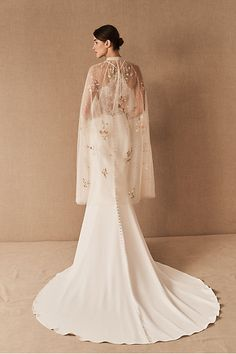Petunia Cape from BHLDN To nail down a whimsical vintage aesthetic, this knee-length cape ticks all the boxes. With dotted tulle, a ruffled neckline and sequined embroidery, it instantly elevates your wedding day look. Camouflage Wedding Dresses, Big Wedding Dresses, Wedding Dress Types, Wedding Dress Sleeves, Long Sleeve Wedding, Wedding Accessories For Bride, Bridal Accessories, Vintage Gowns, Vintage Dress