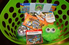 skylander party favors, bucket, slingshot (shroom booms sling shot), cards, drink (different character stickers from @SkylandsAndBeyond.com ) , fire balls, skittles (whirlwinds rainbow of doom), and koosh ball all from dollar store with skylander says. KIDS LOVED THEM!