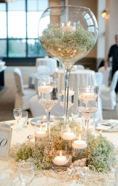 Spring wedding ideas--Baby and candle in the glasses wedding centerpieces, wedding table settings, rustic boho wedding, wedding reception ideas Wine Glass Centerpieces, Unique Wedding Centerpieces, Wedding Reception Decorations, Wedding Themes, Unique Weddings, Centerpiece Ideas, Trendy Wedding, Wedding Ideas, White Centerpiece