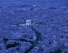 Paris, France: Paris by moonlight? Give us twilight, as The Arc de Triomphe illuminates and cars negotiate the Place Charles de Gaulle