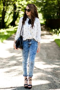 Acid wash jeans with white VJ style shirt..