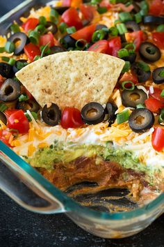 My favorite recipe for Bean Dip! Packed with flavor and always a crowd pleaser. Perfect game day food or party snack. My favorite recipe for Bean Dip! Packed with flavor and always a crowd pleaser. Perfect game day food or party snack. 7 Layer Bean Dip, Layered Bean Dip, 7 Layer Taco Dip, 7 Layer Mexican Dip, 7 Layer Dip Recipe, Mexican Bean Dip, 7 Layer Salad, Best Layered Dip Recipe, Easy Taco Dip