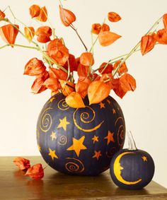 Have you ever thought of using negative space to decorate your Halloween pumpkins? Strategically scratch off a coat of spray paint to reverse the usual painted-pumpkin color combination. Click through for the tutorial and more Halloween painted pumpkin decorating ideas.