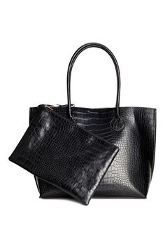Shopper in crocodile-patterned imitation leather with two handles at the top and a magnetic press-stud fastener. Unlined. The matching clutch bag is attache