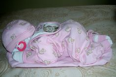 """""""Sleeping Baby Diaper Cake"""" Be the talk of the town...made of diapers and baby items."""