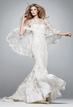 Brides.com: 10 Unforgettable Wedding Gowns. The cape, an increasingly popular accessory, adds a fashion-forward touch to this silk-chiffon mermaid gown, which is embellished with Chantilly lace and tulle-and-organza roses. Dress, Manuel Mota for Pronovias.