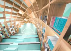 Biblioteca Conarte by Anagrama. Mexican firm Anagrama has installed a dome of interlocking wood panels at a library in Monterrey, creating bookshelves that arch over a stepped reading area Cabinet D Architecture, Interior Architecture, Interior Design, Library Architecture, Modern Library, Library Design, Bookstore Design, Surface Magazine, Bibliotheque Design