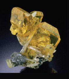 Anglesite is a lead sulfate mineral with the chemical formula PbSO4...with Cerussite - Morocco