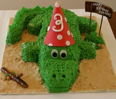 gotta have this one with a blue hat.. alligator birthday cake