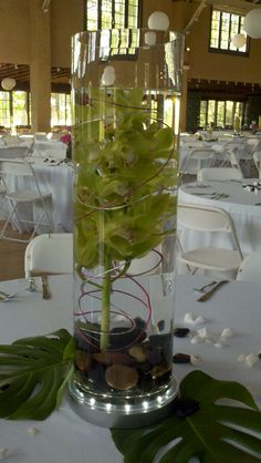 submersed green cymbidium orchid, river rocks and wiring for a Hawaiian themed wedding