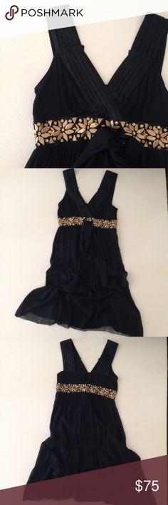 """Banana Republic Black Silk Dress Banana Republic Black Silk Dress. Empire Sheath Silhouette. V-Neck Line. Gold Metallic Embroidered around Waistline. 30"""" chest 30"""" length. Perfect Holiday Dress. Excellent Condition -no Flaws no Fading. Retail $178.00 #09021608 Banana Republic Dresses"""