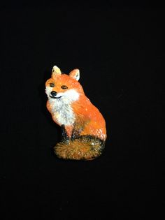 Polymer clay fox brooch.. I thought I would try something different and made this by building up layers of coloured clay. Tricky but I think it looks quite good