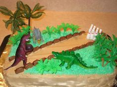 I made this cake for my son's fifth birthday.  He had a dinosaur-themed birthday party at the bowling alley, so we decided to combine the two themes into