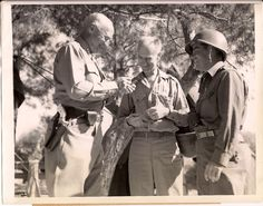 WW2 era press photo of Army General Patton and press reporter Ernie Pyle somewhere in Sicily.