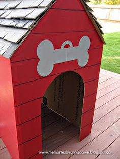 cardboard box dog house for puppy party-we just did black construction paper tiles and we painted M's name on the bone. The kids loved it.