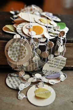 round paper and fabric, and then throw some old photos attached by clothes pins?