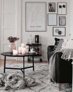 Black and white gallery wall in a living room
