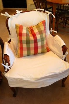 Chair slipcovers! @Jillian Pruitt, she also has video tutorials that I'm going to check out.
