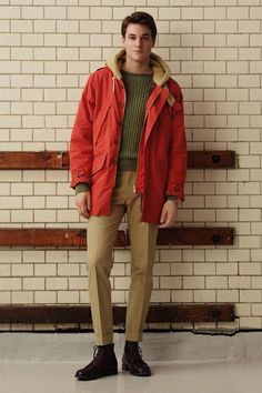 Shop this look on Lookastic:  http://lookastic.com/men/looks/olive-cable-sweater-red-parka-khaki-dress-pants-dark-brown-boots/5359  — Olive Cable Sweater  — Red Parka  — Khaki Dress Pants  — Dark Brown Leather Boots