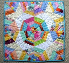 Spiderweb Mini Quilt -  I especially like the stars encased in this pattern!