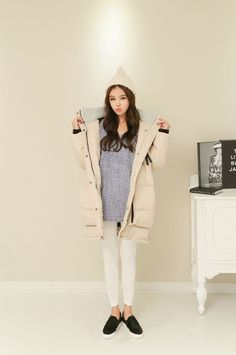 Cream puffy jacket with a grey shirt and skinny jeans. Love!!