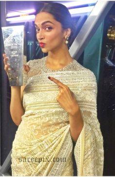 Beautiful diva Deepika padukone saree photos at NDTV Indian of the year awards 2016. She was beautiful in Abu Jani Sandeep Khosla designed white saree. Red