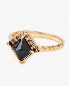 "Inverted princess cut black diamond ""Raziel"" ring with black to white gradient diamond pave set in 14k yellow gold, $2,780; catbirdnyc.com."