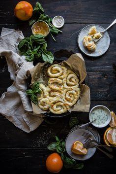 orange-almond sweet rolls with basil glaze   two red bowls