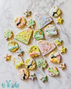 Watercolor style sugar cookies decorated with royal icing and gold leaf, made for our beloved Irish step dancing teacher.