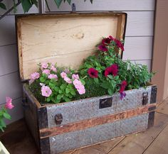 front porch idea...flowers put into pots with water trays and then placed inside grandma's old trunk