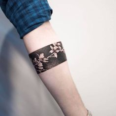 Cherry blossom armband tattoo.