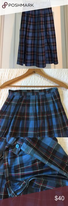 """•VTG• Plaid Midi Skirt Small This estate treasure is part of 5 skirts of the same size and age listed separately in my closet. Please let me know if interested in a bundle of these amazing skirts! Excellent vintage condition. Side metal zip dates this to 50's early 60's. Zipper works as does the pretty blue Button . 12"""" waist , Length 25"""". Beautiful Craftsmanship. Cotton/Blend. Plaid is squares of blue black red and white. Lovely!  One one tiny pull as shown. Thanks for looking!! ✨✨ Vintage…"""