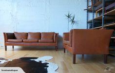 Perfect retro leather sofas.  Maker: Mogens Hansen  Design: Inhouse  Origin: Denmark  Circa: 1970  Materials: Buffalo Leather , Scandinavian Beech