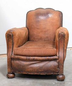 "MILNE AT HOME ANTIQUES KINGSTON, 845-331-3902  ""I was so super excited to discover the antique French mustache back leather club chairs . . . it had been a long time since I had seen an all original pair like these, right down to their bronze tacks."""