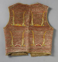A LAKOTA ELK DREAMER'S SOCIETY QUILLED HIDE PICTORIAL VEST composed of hide, cloth and porcupine quills. Length 19 in.