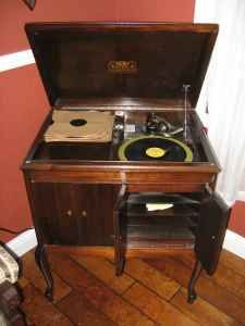 Need to possibly refinish our Victrola in the attic and put it in the living or dining room