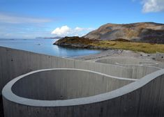 Architizer Blog » A Snaking Concrete Pavilion that Links the Roadside to the Ocean