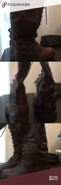 Brown lace up boots These are brown lace up boots with a buckle at the bottom in a buckle at the top and good condition Shoes Lace Up Boots