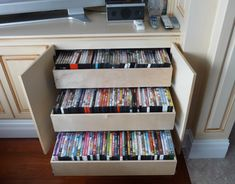 Increase your living room space with the use of hidden shelving . This roll out shelf is ideal storage solution.