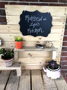 DIY Mud Kitchen for $10! Backyard Play, Backyard For Kids, Outdoor Play, Diy Mud Kitchen, Kitchen Set Up, Metal Sink, Kitchen Chalkboard, Pallet Boards, Used Parts