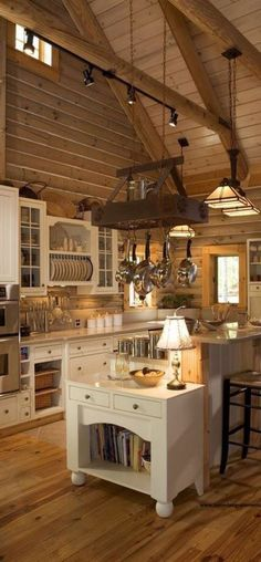 Rustic kitchen... Nice mix of warm tones and light cupboards / counters...