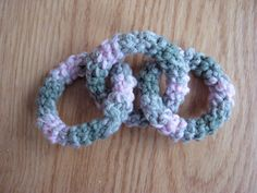 Strings to Things: Knit bib and crocheted baby toy