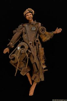 "Brenna Busse: Rhythm of Rust: ageless grace  rusted metal, fabric, clay 28x10x5"" ©2009"
